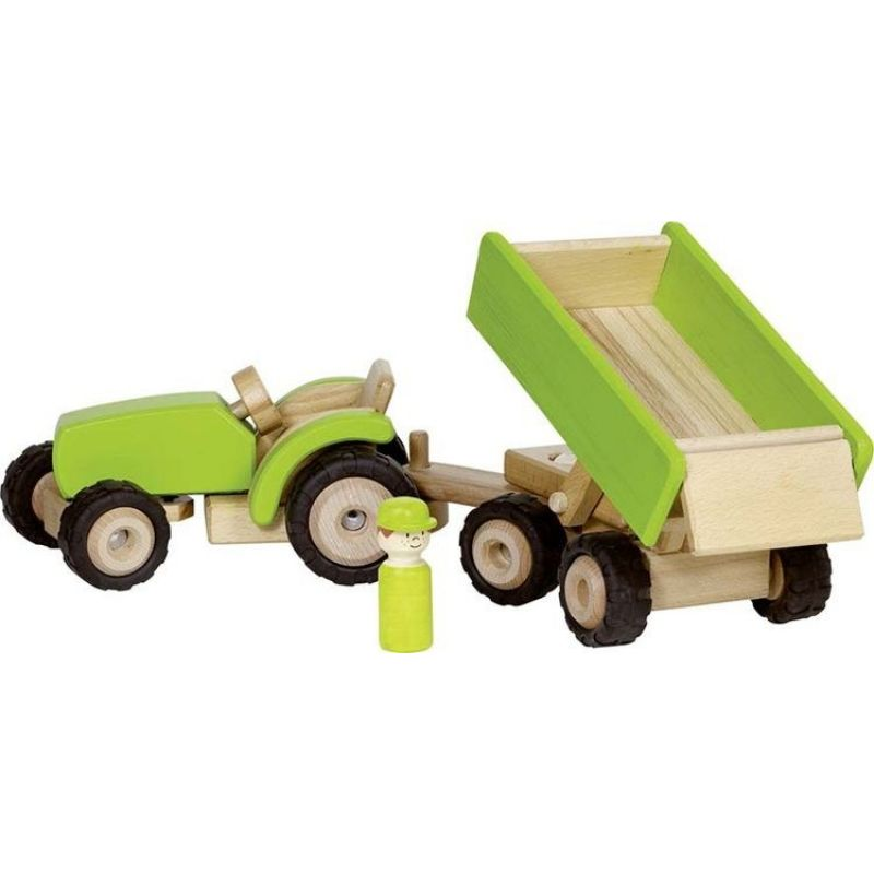 Zielony traktor z przyczepą